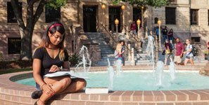 student studying at the H2O Fountain outside the Chemistry building