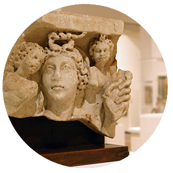 ancient European column capital with three faces