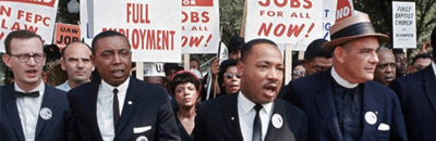 Martin Luther King, Jr. marching with supporters