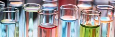 test tubes filled with liquids of various colors