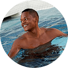 Round image of student swimming