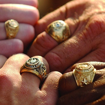854bedcb1 Four people showing their Aggie Rings